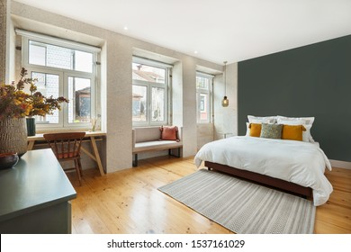 Light modern interior design, apartment with double bed and big windows