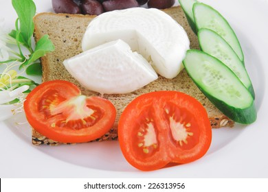 light mozzarella and bread with vegetables on plate