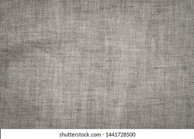 Light natural linen texture background. Wrinkled grey fabric background. Ancient linen cloth texture, close up macro.