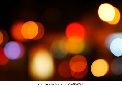 Light night at city blue bokeh abstract background blur lens flare reflection beautiful circle glitter lamp street with dark sky festival firework