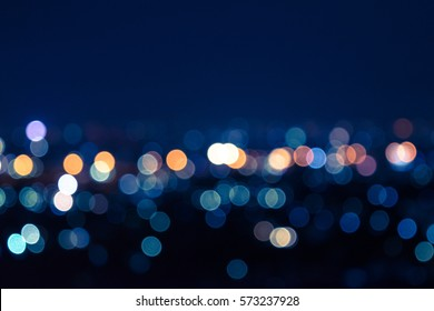 Light night at city bokeh blur abstract background. Blue black focus flare.