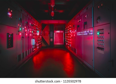Light on at Electrical selector switch,button switch,Electrical switch gear at Low Voltage motor control center cabinet in coal power plant at night.
