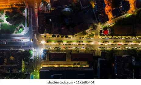 The light on the road roundabout at night and the city in Burgas, Bulgaria. Road beautiful Aerial View of Busy Intersection, Aerial view. Top view. Background scenic road. curves road drone view