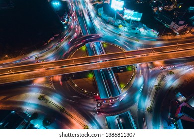 The light on the road roundabout at night and the city in Bangkok, Road beautiful Aerial View of Busy Intersection, Aerial view. Top view. Background scenic road.