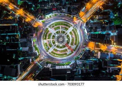 The light on the road roundabout at night and the city in Bangkok, Thailand. Aerial view. Top view. Background scenic road.