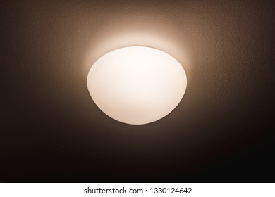 The light on the wall. Circular light. Light and heat source. Energy saving.