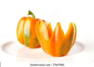 light orange bell pepper isolated over white