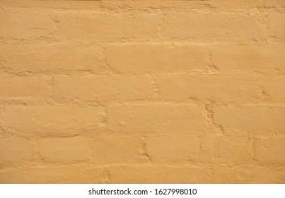 Light Orange Textured Old Brick Wall