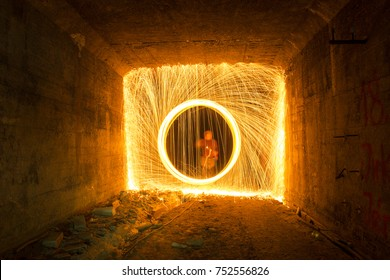 Light painting / light drawing with fire and steel wool underground