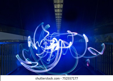Light painting / light drawing with spotlight in the city