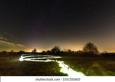 Light painting in the landscape with meadow and trees