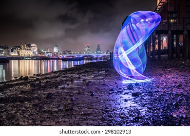 Light painting on the south bank of the river Thames in London