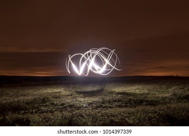 Light painting with a torch in the fields at Halnaker at night