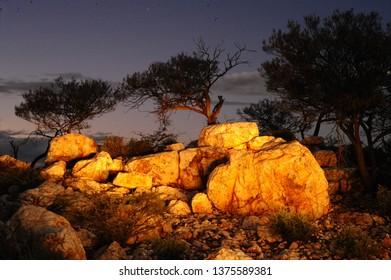 Light painting at twilight, of large boulders of white Quartz, illuminating the white rocks.