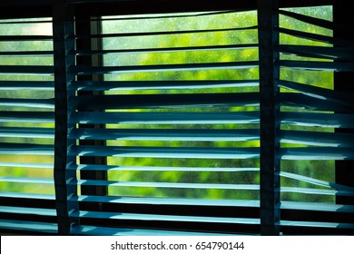 light passes through the dilapidated windows blinds