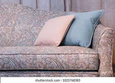light pearl cushioned furniture sofa with cushions and armchair
