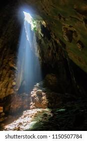 Light peering into the Dark Caves at Batu Cave site