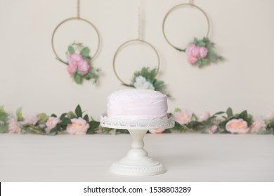 Light Pink Cake with Florals and Greenery