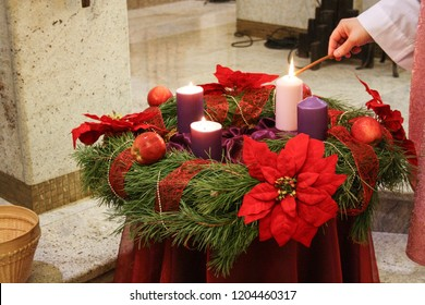 Light a pink candle on the Advent wreath