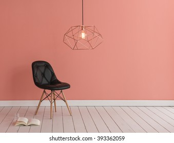 light pink color wall with modern lamp and black chair concept
