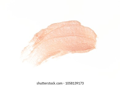 Light pink cosmetics products on white