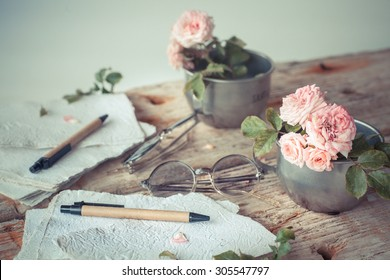 Light Pink roses on wooden table background with copy space, Romantic floral theme