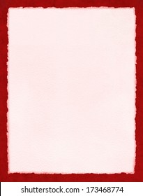 Light pink watercolor paper with true deckled edges on a textured red background.  File includes a clipping path.