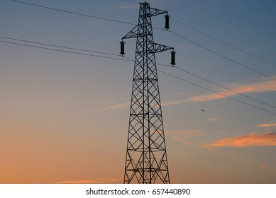 Light pole isolated against colorful sunset sky