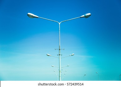 Light post isolated with blue sky background