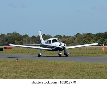 Light private airplane taxiing on the ground