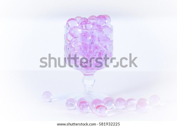 Light purple aroma beads in a glass