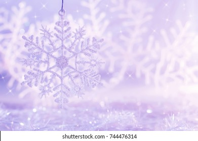 Light purple background with snowflakes. Christmas background