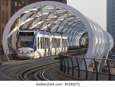 Light rail train traverses a flyover in The Hague City Center