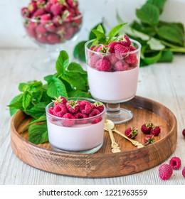 Light raspberry mousse panna cotta dessert in glasses