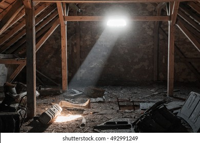 Light ray from the open window on the creepy attic