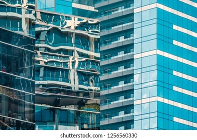 light reflecting in the glass windows of modern tall office blocks creating interesting contemporary abstract patterns