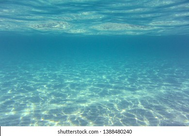 Light reflections of the water surface on the sea bottom
