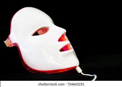Light rejuvenating mask for facial skin therapy on black background