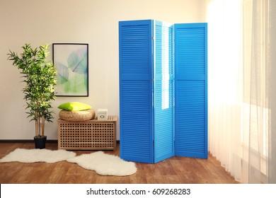 Light room interior with blue folding screen