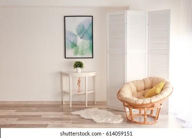 Light room interior with folding screen