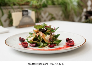 Light salad with goat cheese and cherry dressing