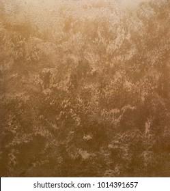 Light sand streaks on a dark, bronze background. Interior Design. Decorative coating for walls - sand