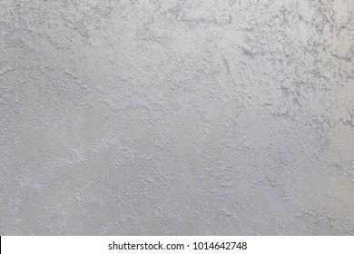 Light sand streaks on a dark, steel background. Interior Design. Decorative coating for walls - sand