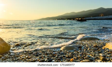 Light sea surf shot close at sunset