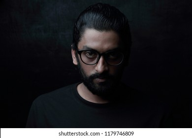 Light and shade portrait of a young man in dark background