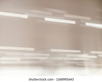 Light and shadow bokeh. Abstract background of a white wall with shadows from the window. Solar glare