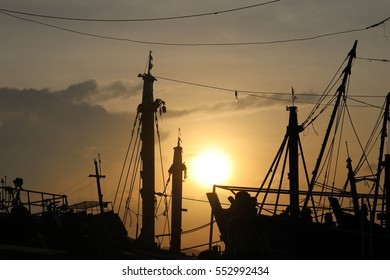 light and shadow in harbor on sunset