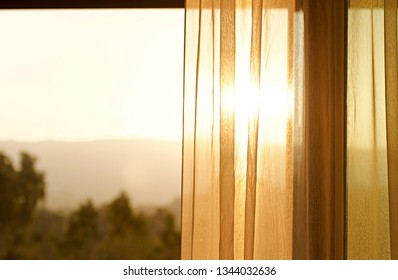 The light and shadow of morning climate on the inner silk blinder or curtain. The exotic light pass through the tree the shadow and light ray up on the scene. Morning background concept.Warm tone.