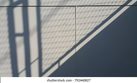 Light and shadow on steel fence , texture
