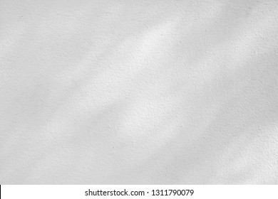 Light and shadow reflected on white wall with effect of black and white tone